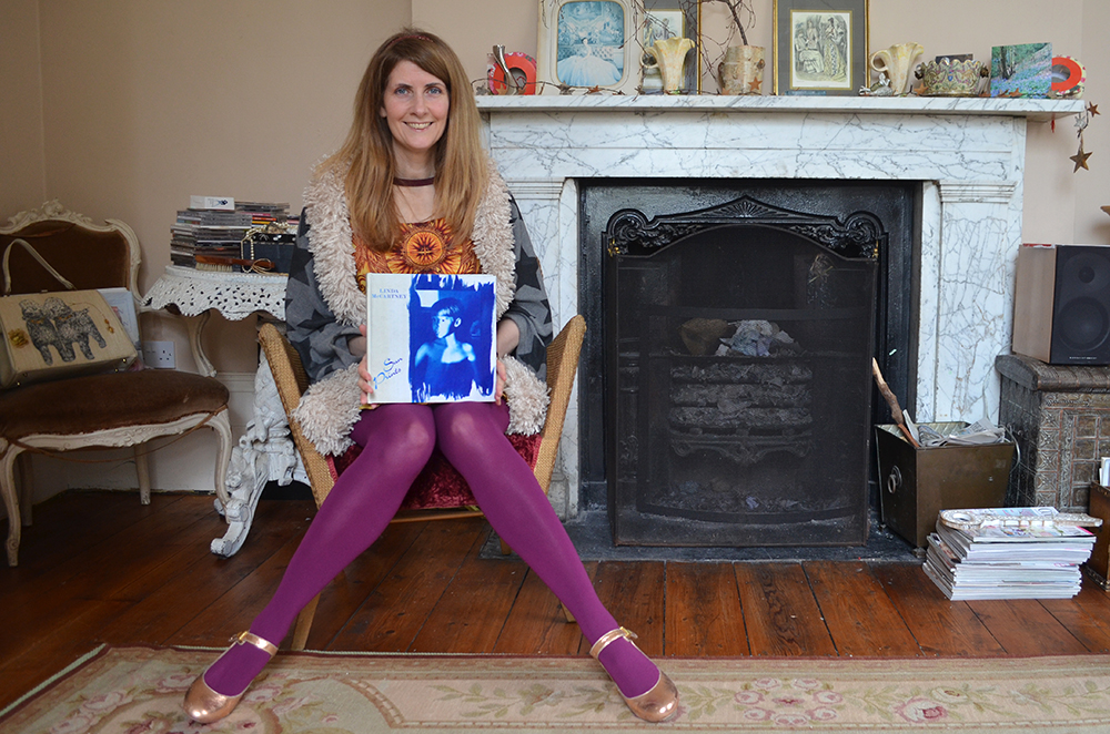 Feature and Fashion writer Alison Jane with her treasured copy of Sun Prints by Linda McCartney.