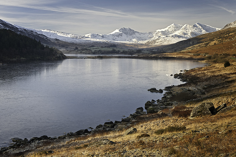 Llynnau Mymbyr View to Snowdon Horsehoe with snow on mountains and lake frozen Capel Curig Conwy County Snowdonia North Scenery