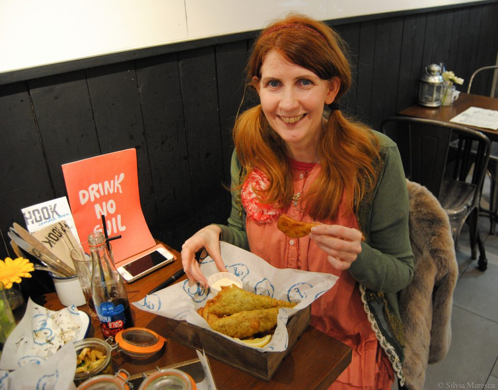 Our Editor, AJ, Enjoying Sustainable Seabream and Chips, Washed Down with Karma Kola.