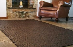 Upcycled Leather Rug by Elvis and Kresse