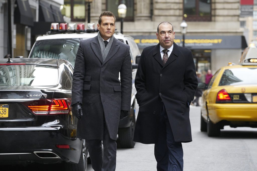 Suits Season 7 - The Tiny Violin Episode with Gabriel Macht as Harvey Specter and Rick Hoffman as Lewis Litt.