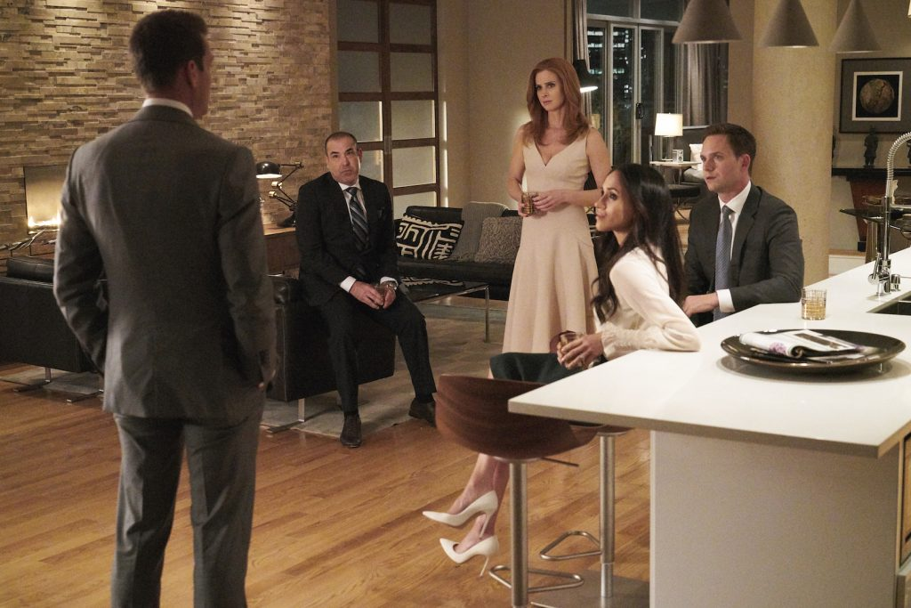 A scene from Suits where Harvey Specter talks to Lewis, Donna, Mike and Rachel.