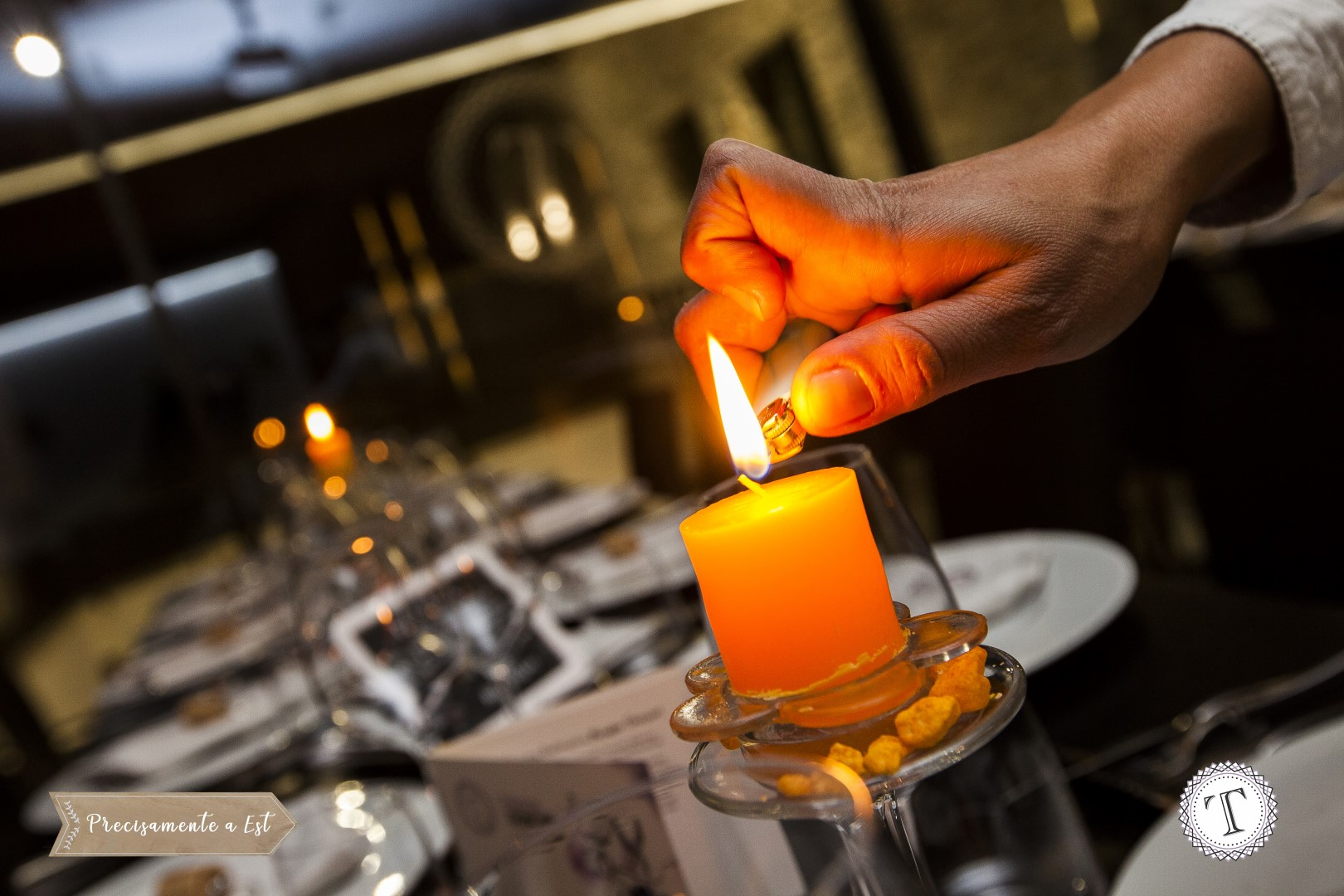 A candle is lit at dinner time at Palazzo Tronconi.