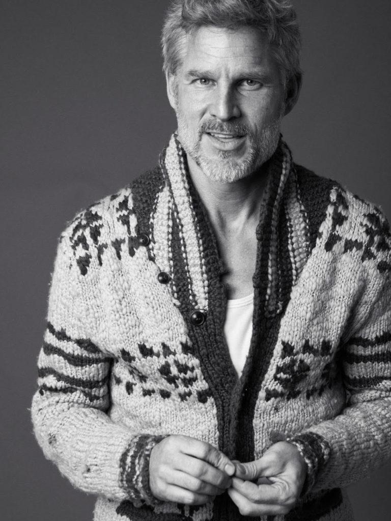 Actor and Model Noah Huntley wearing a handmade artisan cardigan.