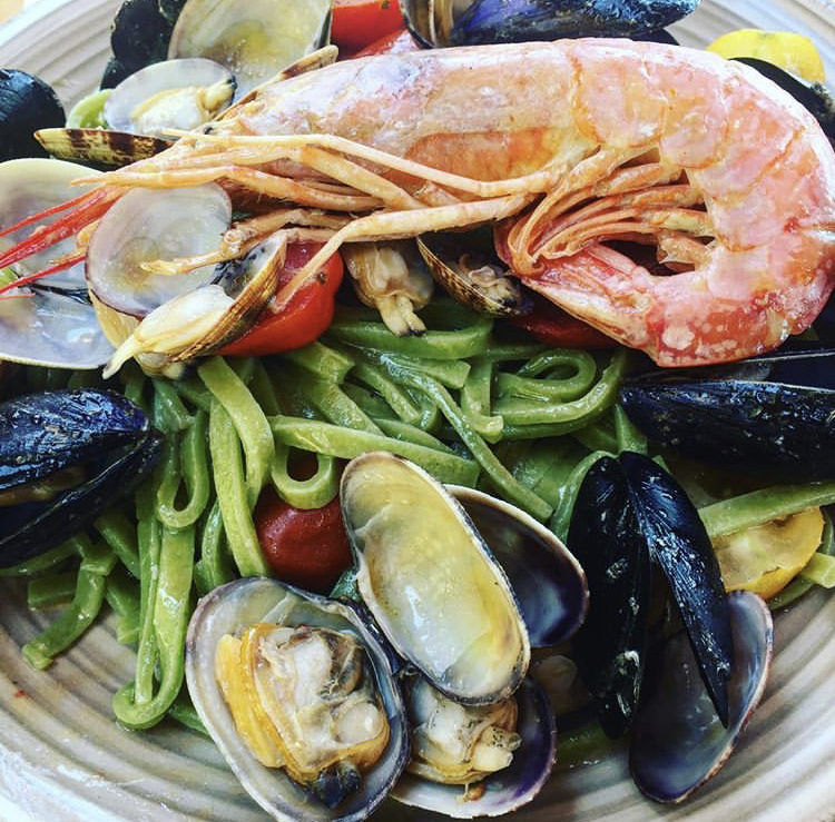 Local seafood with pasta in Sperlonga, Italy.