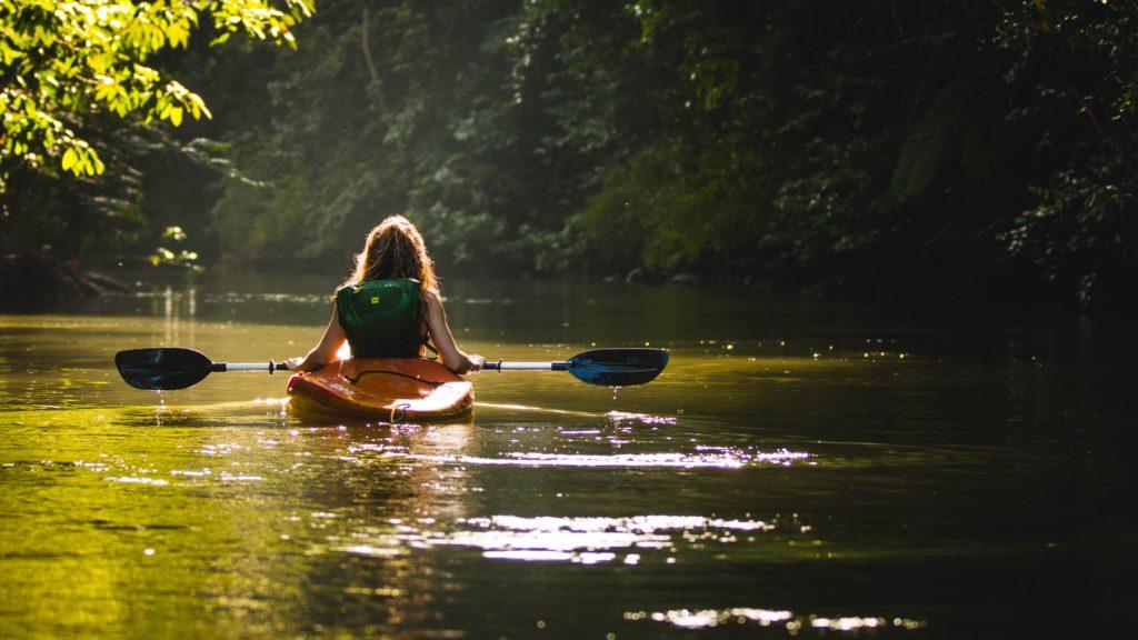 Girl in a canoe by Filip Mroz