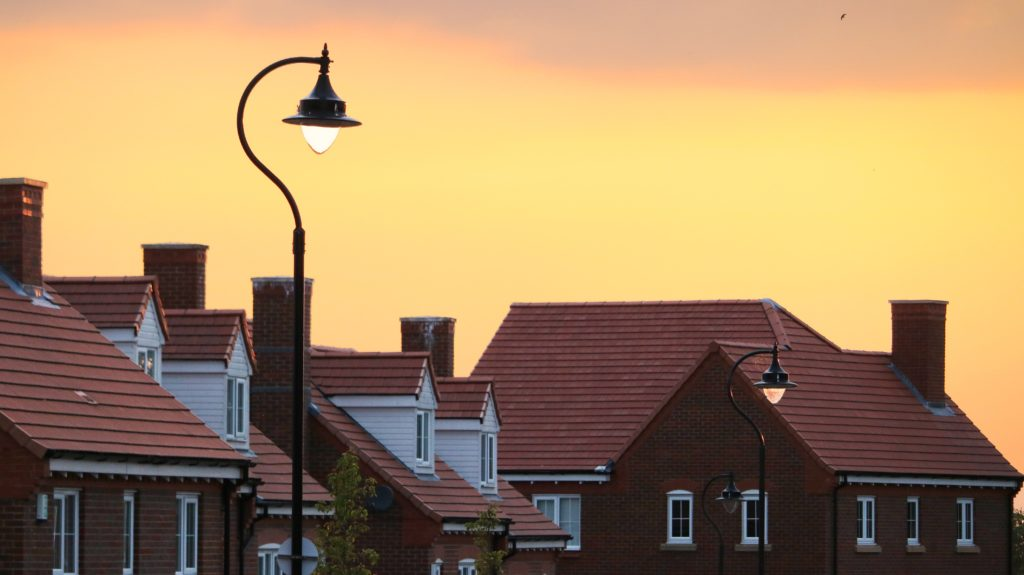 Rooftops at sunrise by Tom Thain
