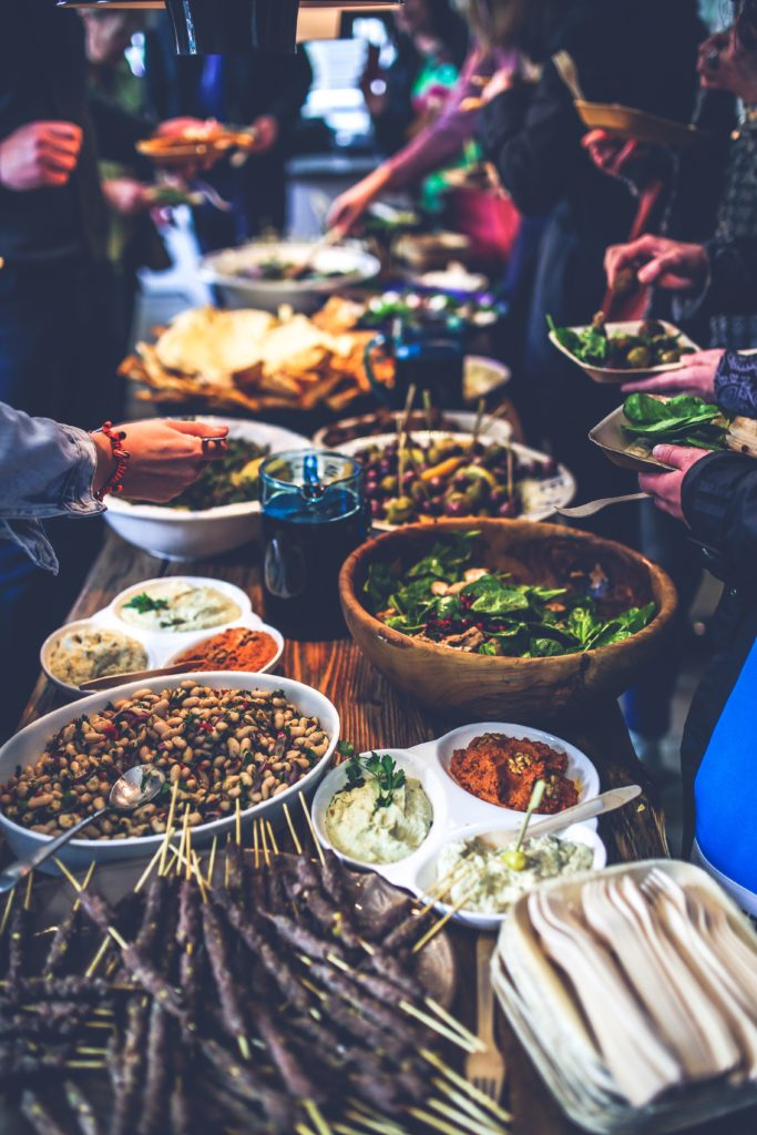 Traditional organic Greek food served family style. Photo by Kaboompics.com from Pexels.